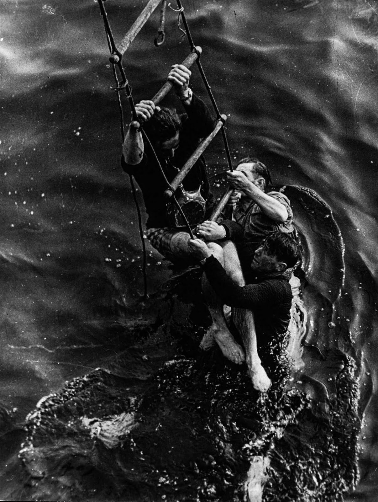 Allied soldiers climb aboard a ship during the evacuation of Dunkirk.
