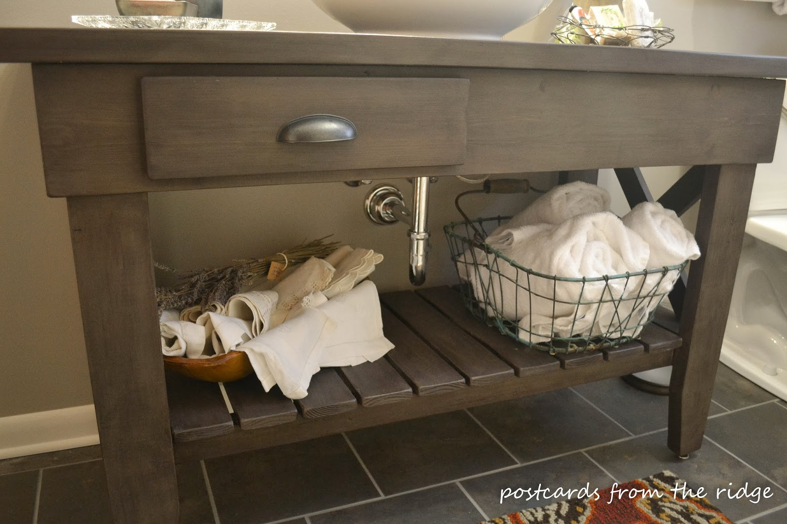 A gorgeous custom vanity with a shelf for storage.  I love this!  Lots of other great ideas for bathroom remodels found here too.