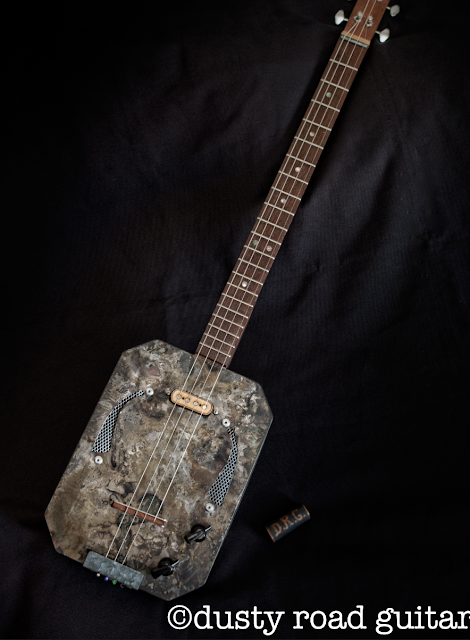 """ The Rusty Howler "" 4 string burned can guitar."