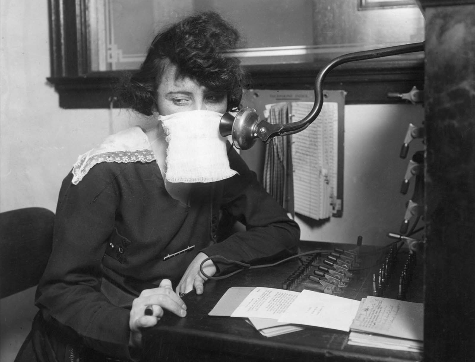 A telephone operator with protective gauze in 1918.