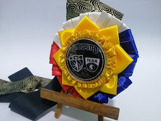 "Philippine-inspired rosette ribbon leis provided for the judges of the american bully kennel club and bendovah bully camp during their ""Undisputed"" dog show event."