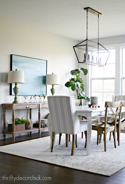 Dining area with white table and wood chairs