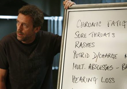 House MD, Hugh Laurie writing on whiteboard.