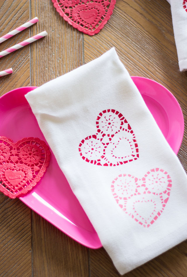 Doily stamped napkins - the perfect addition to a Valentine's Day table! | http://www.designimprovised.com