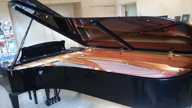 used Yamaha CF-3 9-foot concert grand piano on Grafton PIano's floor - side shot