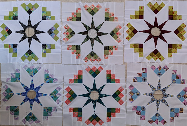 This set of six blocks has fussy cut components to highlight the prints on the fabric.