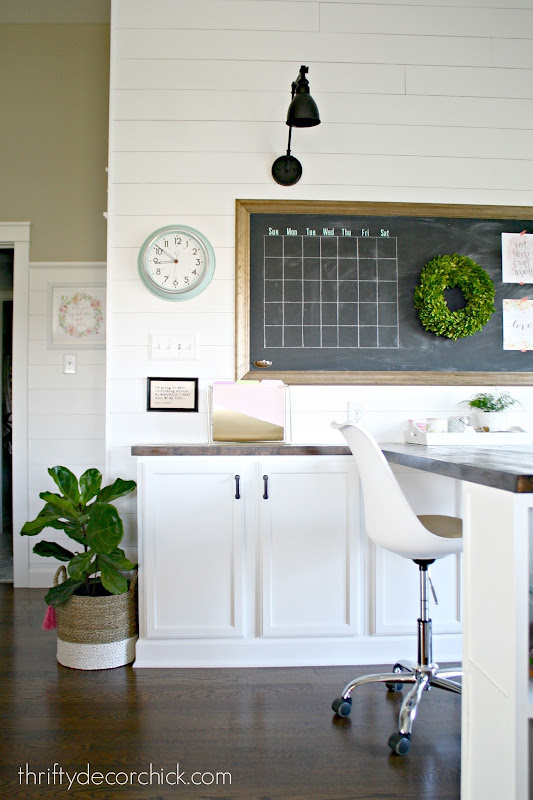 white shiplap walls with sconces