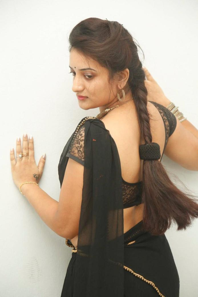 Beautiful Telugu Girl Hip Navel Show Stills In Black Saree Janani