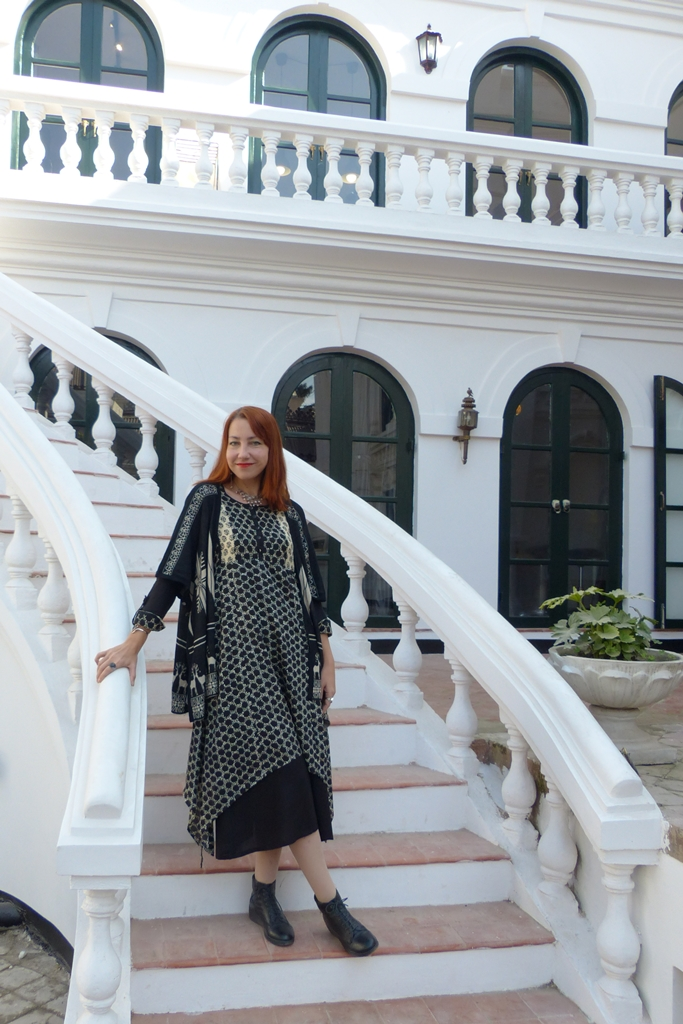 Polka dots black and white dress worn with printed poncho