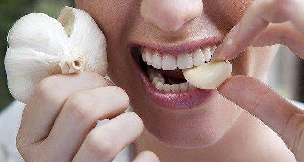 Garlic Clove Between Her Lips