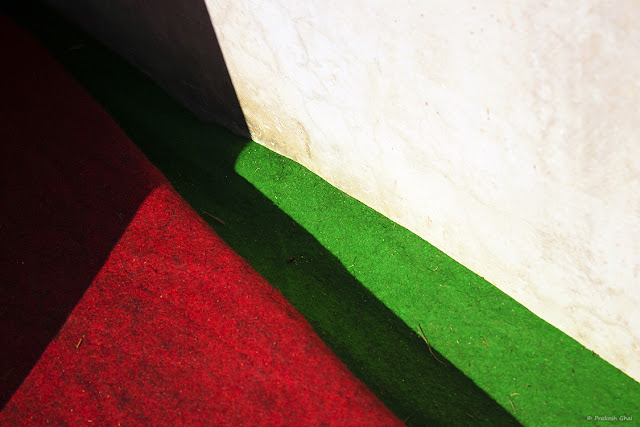 A Minimalist Photo of Red and Green floor carpets.
