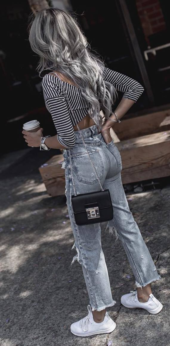 trendy casual outfit: top + ripped jeans + bag