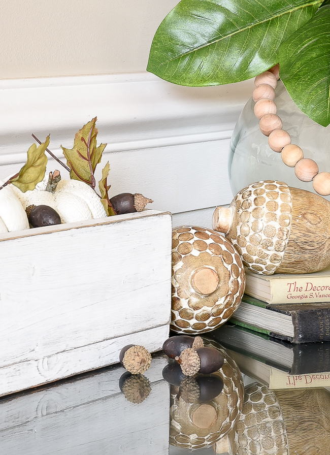 Decorating with Dollar Tree pumpkins and acorns