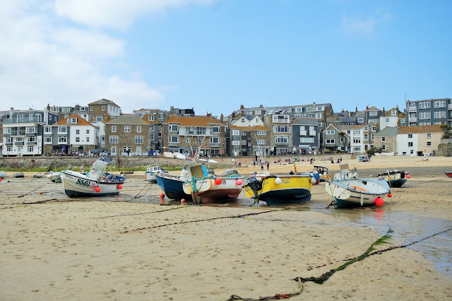 Fishing Boats rest on the sand at low tide, St Ives Harbour