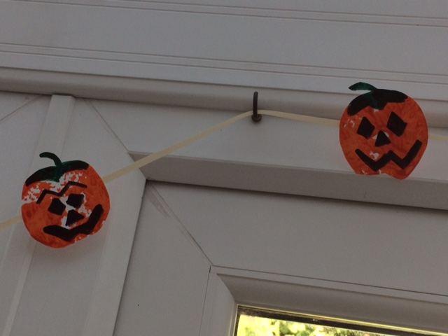 Pumpkin bunting hang around a door frame