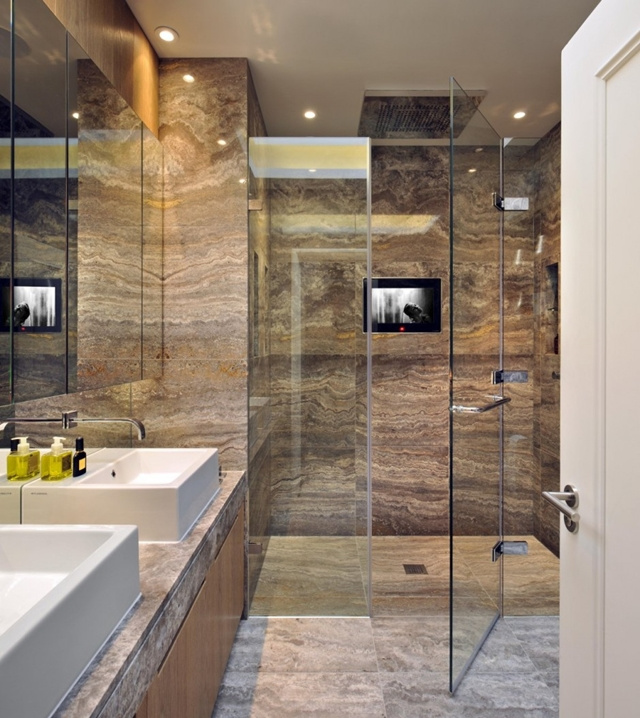 Glass shower cabin in the bathroom