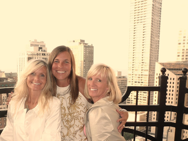 Three friends on balcony Waldorf Chicago by Hello Lovely Studio