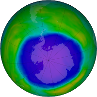 The ozone hole over Antarctica, captured by NASA's Aura satellite on October 2, 2015. A new study shows the Montreal Protocol, the international treaty adopted to restore Earth's ozone layer in 1989, has significantly reduced climate-altering greenhouse gas emissions from the U.S. (Credit: NASA Earth Observatory) Click to Enlarge.