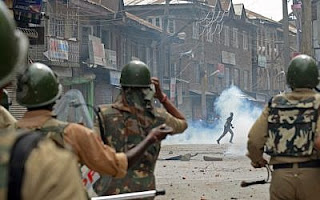 Clash with india police :Kashmiri demonstrators clash with Indian police and soldiers during a demonstration against Israeli military operations in Gaza, in downtown Srinagar on July