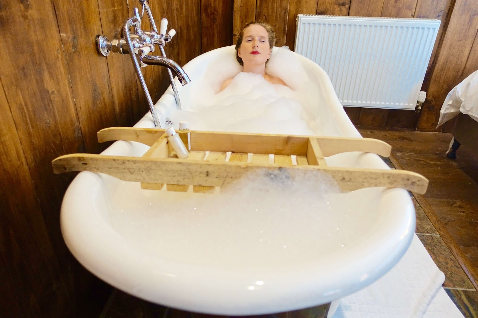 relaxing in the roll top bath