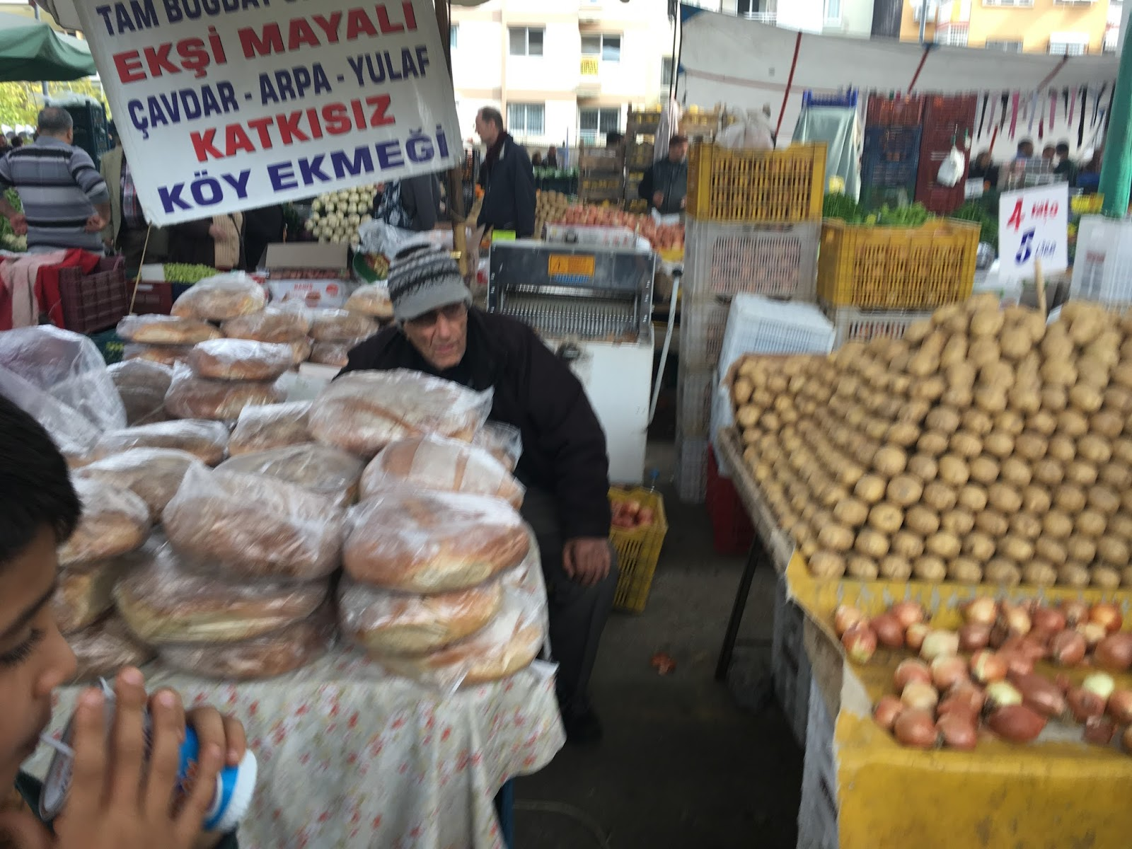 LeeZe visits Izmir Sunday farmer's market. Various made breads made in the local villages next to a potato seller.