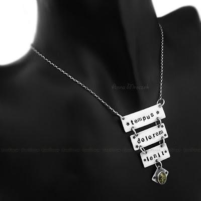 https://www.etsy.com/listing/100338951/tempus-dolorem-lenit-talisman-amber?ref=shop_home_active_9