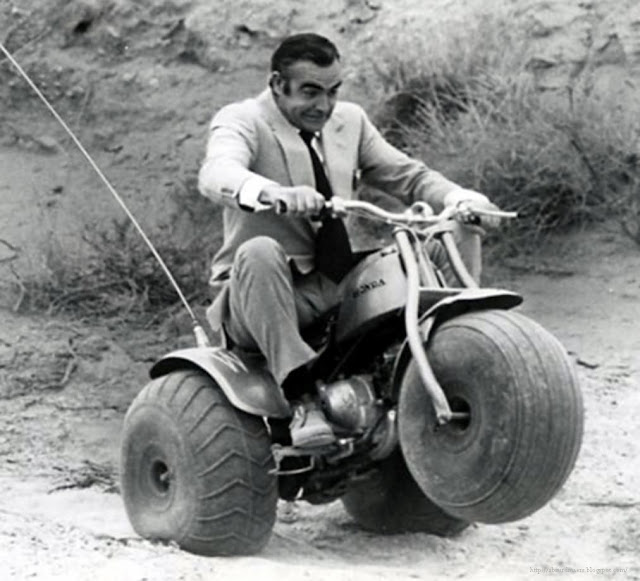 Sean Connery popping a wheelie on an ATV while filming Diamonds Are Forever, 1971