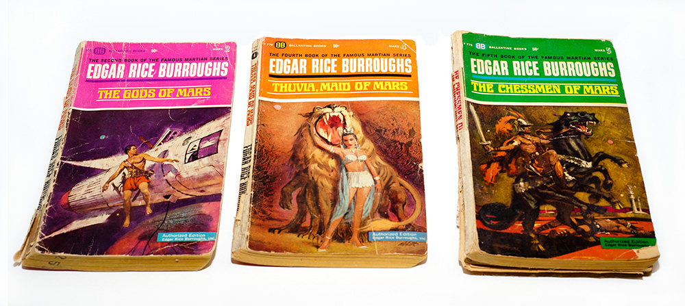 Three novels from the Mars series by Edgar Rice Burroughs showing the cover art used in the 1960s