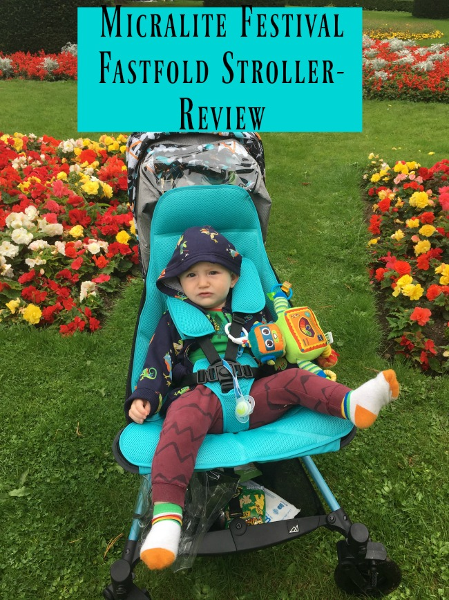 Micralite-Festival-Fastfold-Stroller-A-Review-text-over-image-of-baby-in-stroller-near-flowers