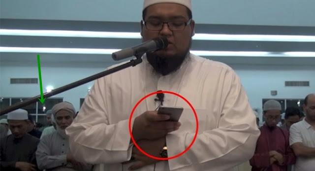 Hukum Syar'i Yg Di Selewengkan,,! Imam Ini Membuka HP Saat Memimpin Shalat Berjamaah. Sah Tidakkah Shalatnya.,?