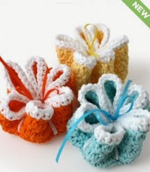 http://www.yarnspirations.com/pattern/crochet/ribbon-flowers-dishcloths