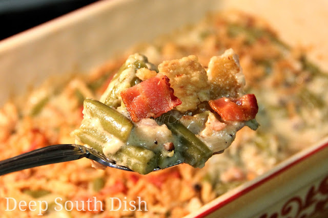 Green Bean Casserole made with a homemade, butter roux based cream sauce, enhanced with bacon, fresh vegetables and mushrooms.