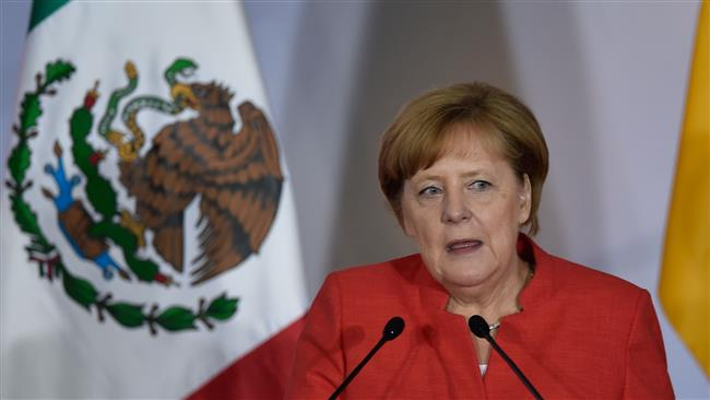 German Chancellor Angela Merkel says walls won't end immigration issues