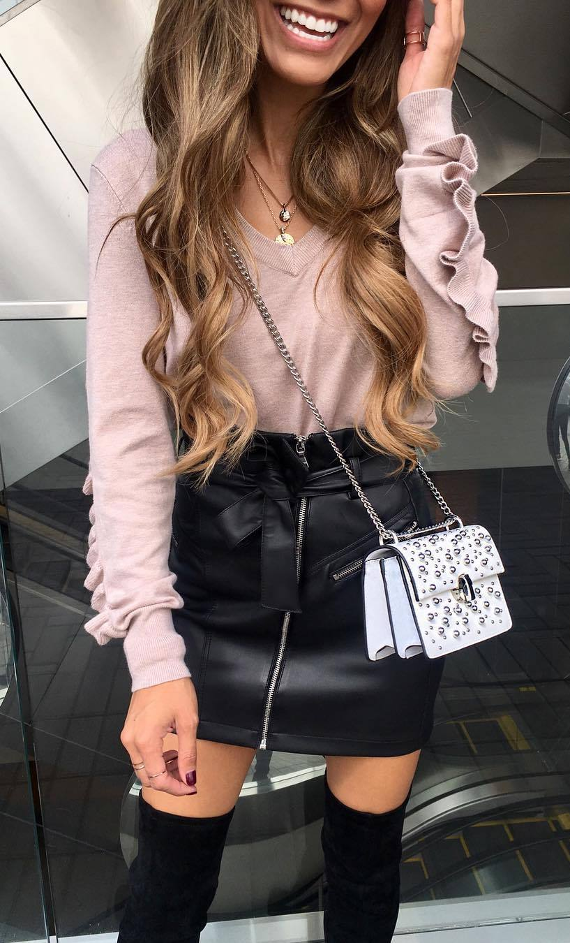 what to wear with a leather skirt : crossbody bag + ruffle sweater + over knee boots