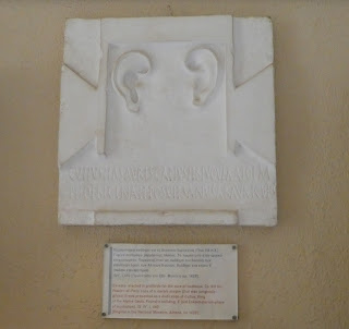 Plaster cast of a plaque showing two human ears