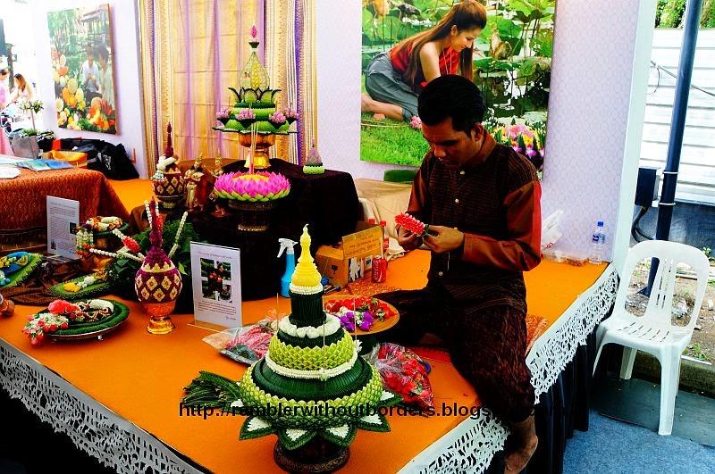 Thai artisan creating ritual ornament from flowers