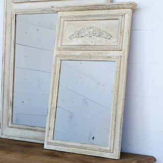 A French farmhouse style mirror reproduction that is affordable and just as beautiful as an antique mirror.