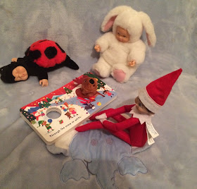 Elf on the shelf reading a story to toys