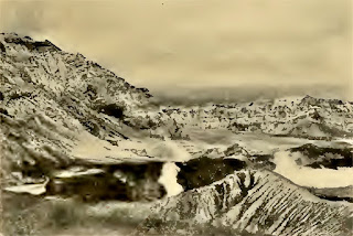 The same crater in September 1904.  The eruption has almost completely died down.  The boiling crater lake is shown on the right of the active cone.