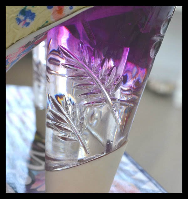 close up detail of purple perspex heel on shoe