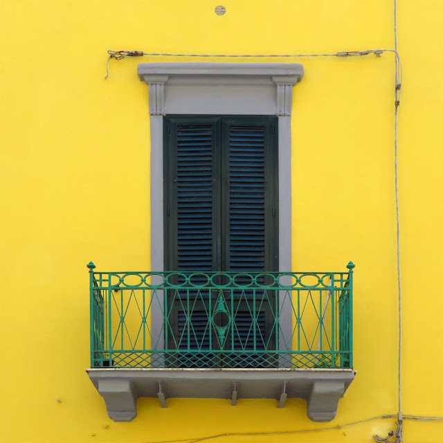 Green balcony, yellow facade, Via Ernesto Rossi, Livorno