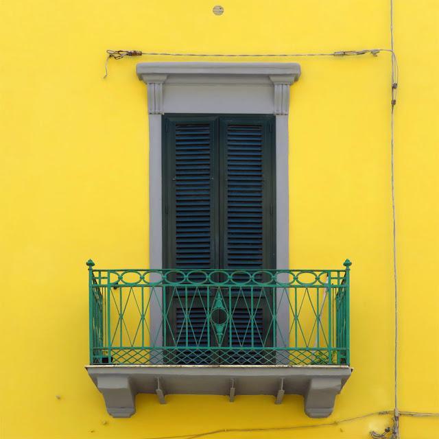 Green balcony, yellow facade, Via Ernesto Rossi, Livorno