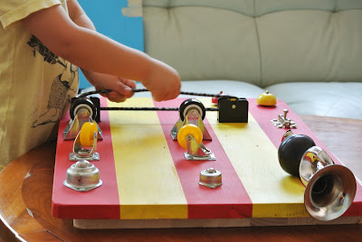 toddler playing with sensory board