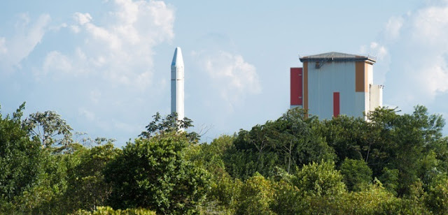 One of Ariane 5's two solid propellant boosters rolls out for mating to the core stage. Photo Credit: Arianespace