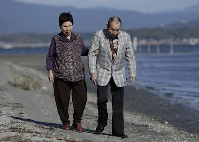 Iwao taking a walk with his sister Hideko
