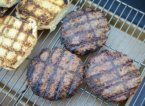 Burgers and buns grilled on Char-Broil gas to charcoal combination grill