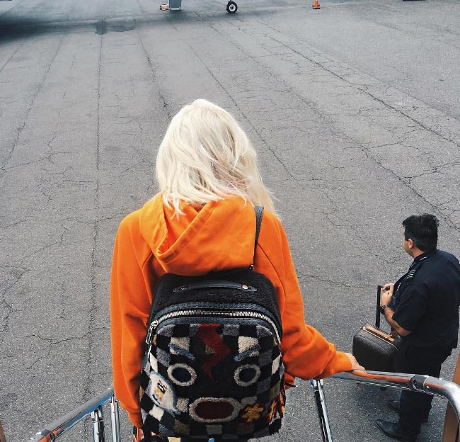 Photos: Kylie Jenner dyes her hair blonde as she arrives New York