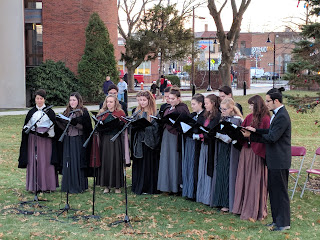 Dean College carolers warmed up the crowd with holiday songs before and after the tree lighting