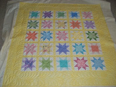 Baby quilt with feathered borders