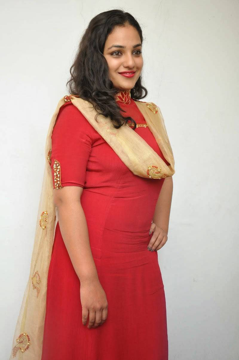 Actress Nithya Menen Hot Photos At Movie Interview In Red Dress